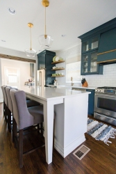 Calcutta-Gold-Quartz-Countertops-with-Blue-Cabinets-Lauren-Brown-Twin-Construction-4