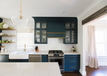 Calcutta-Gold-Quartz-Countertops-with-Blue-Cabinets-Lauren-Brown-Twin-Construction